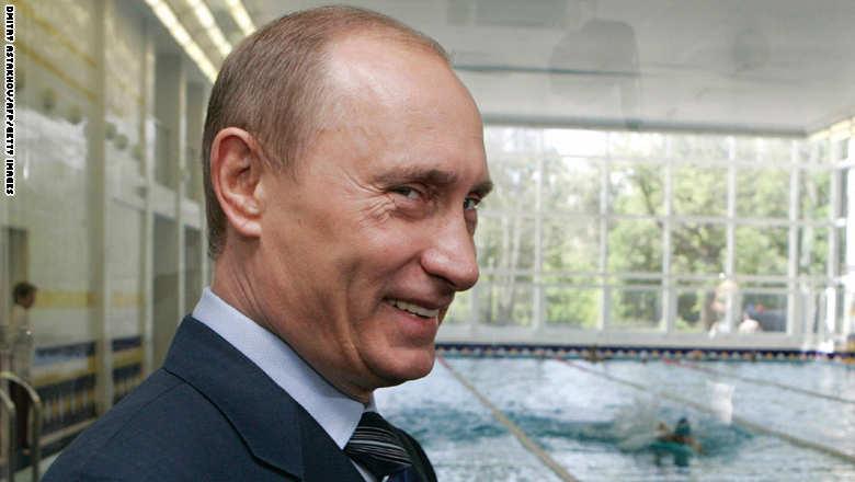 Russian President Vladimir Putin smiles