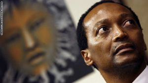 """South African businessman and outgoing Business Unity South Africa (BUSA) president Patrice Motsepe looks on while listening to unseen newly appointed BUSA president Brian Molefe speak on May 07, 2008 at the BUSA headquarters in Sandton. The new head of South African business group BUSA said on May 7, he was """"quite happy"""" about the country's electricity crisis, despite the power cuts and disruption, as it will result in needed change. AFP PHOTO / GIANLUIGI GUERCIA (Photo credit should read GIANLUIGI GUERCIA/AFP/Getty Images)"""