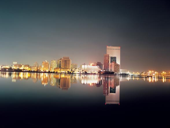 ARTDXG View of the lake and NCB Bank building in Jeddah, Saudi Arabia